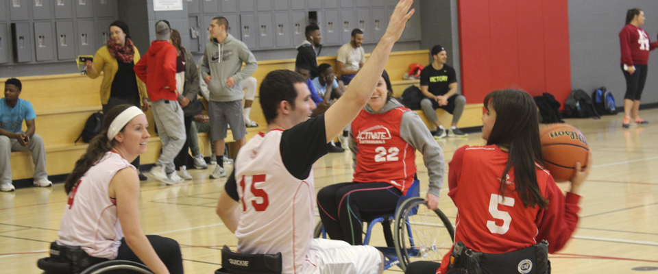 students playing basketball in wheelchairs for Adaptapalooza